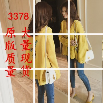 Autumn new Korean fashion pure color loose embroidery hole single-breasted long-sleeved knitted cardigan