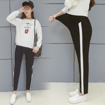 Pregnant women fall and winter leisure care belly pants side white strip pregnant women sports nine pants harem pants 2078